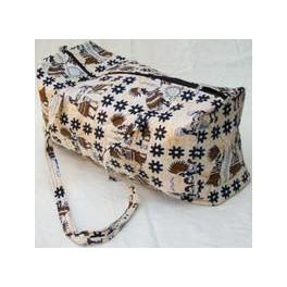 Lysgul taske med mørke mønstre