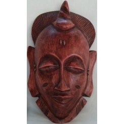 Mørkebrun maske med spiralsnitter